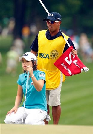 BETHLEHEM, PA - JULY 11:  Eun Hee Ji of South Korea looks over the second green with her caddie Zac Austin during the third round of the 2009 U.S. Women's Open at the Saucon Valley Country Club on July 11, 2009 in Bethlehem, Pennsylvania.  (Photo by Scott Halleran/Getty Images)