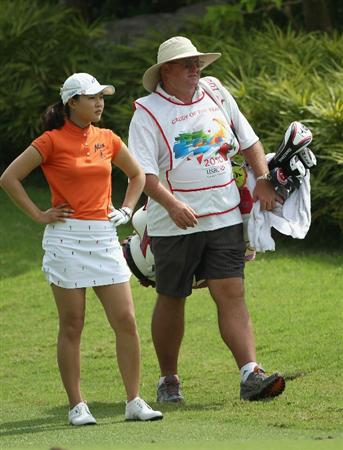 SINGAPORE - FEBRUARY 26:  Hee Kyung Seo of South Korea with her caddie Dean Herden during the third round of the HSBC Women's Champions at the Tanah Merah Country Club on February 26, 2011 in Singapore.  (Photo by Andrew Redington/Getty Images)