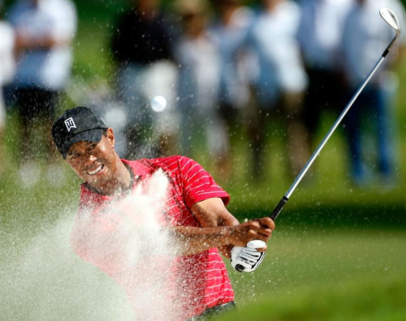 DORAL, FL - MARCH 15:  Tiger Woods hits his third shot on the 7th hole from the sand during the final round of the World Golf Championships-CA Championship on March 15, 2009 at the Doral Golf Resort and Spa in Doral, Florida.  (Photo by Jamie Squire/Getty Images)