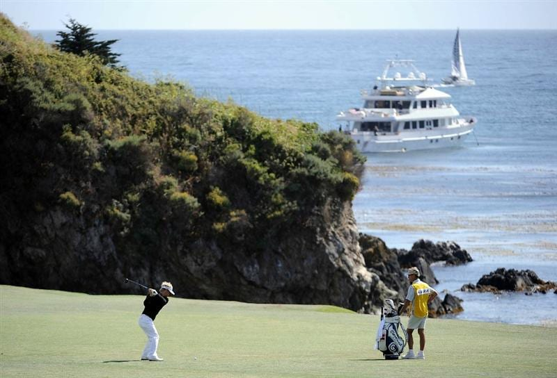 PEBBLE BEACH, CA - JUNE 19:  Soren Kjeldsen hits a shot on the sixth hole as his caddie Kevin Woodward looks on during the third round of the 110th U.S. Open at Pebble Beach Golf Links on June 19, 2010 in Pebble Beach, California.  (Photo by Harry How/Getty Images)