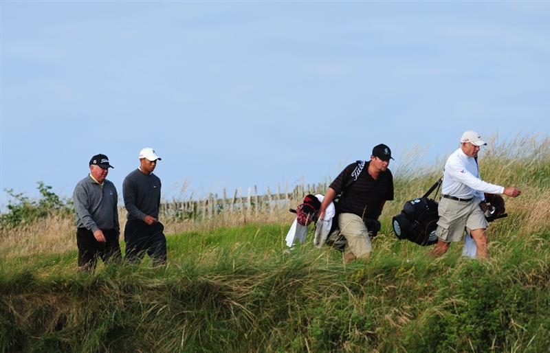 TURNBERRY, SCOTLAND - JULY 14:  Mark O'Meara (L) of USA walks with Tiger Woods of USA during a practice round prior to the 138th Open Championship on the Ailsa Course, Turnberry Golf Club on July 14, 2009 in Turnberry, Scotland.  (Photo by Stuart Franklin/Getty Images)