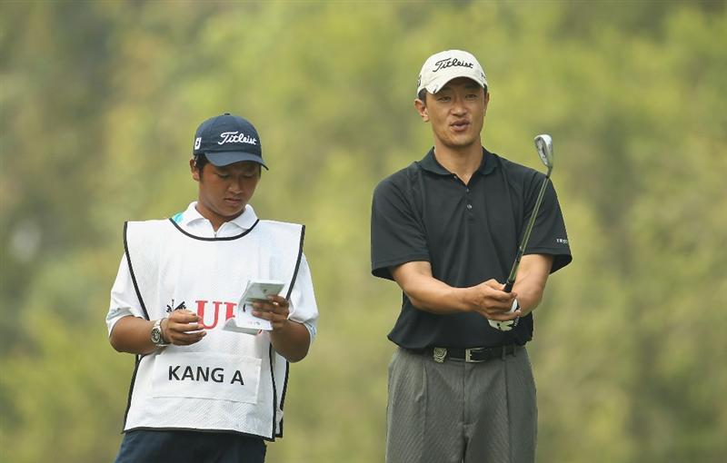 HONG KONG - NOVEMBER 19:  Anthony Kang of the USA looks on during day two of the UBS Hong Kong Open at The Hong Kong Golf Club on November 19, 2010 in Hong Kong, Hong Kong.  (Photo by Ian Walton/Getty Images)