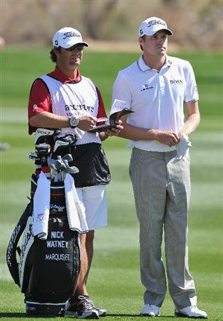 MARANA, AZ - FEBRUARY 25:  Nick Watney and caddie discuss his approach shot on the 10th hole during the third round of the Accenture Match Play Championship at the Ritz-Carlton Golf Club on February 25, 2011 in Marana, Arizona.  (Photo by Stuart Franklin/Getty Images)