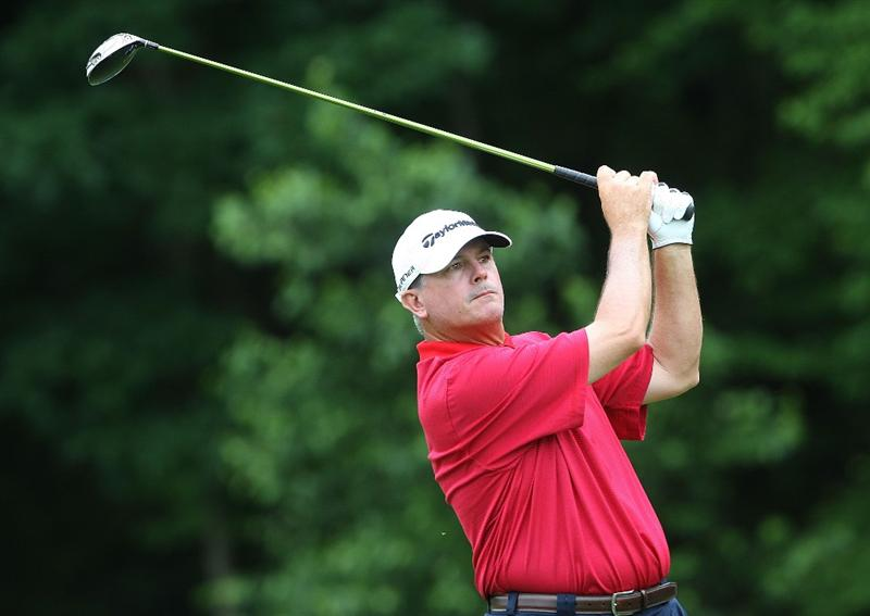 CROMWELL, CT - JUNE 25: Paul Goydos drives from the 14th tee box during round one of the 2009 Travelers Championship at TPC River Highlands on June 25, 2009 in Cromwell, Connecticut. (Photo by Jim Rogash/Getty Images)