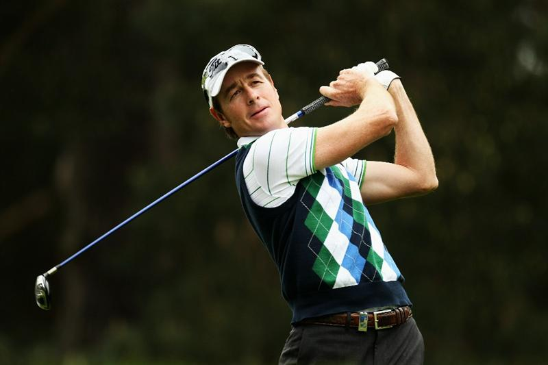 VIRGINIA WATER, ENGLAND - MAY 20:  Brett Rumford of Australia plays a tee shot during the first round of the BMW PGA Championship on the West Course at Wentworth on May 20, 2010 in Virginia Water, England.  (Photo by Ross Kinnaird/Getty Images)