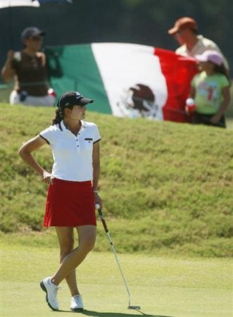 PRATTVILLE, AL - OCTOBER 3:  Golf fans hold a Mexican flag as Lorena Ochoa of Mexico waits to putt on the second green during third round play in the Navistar LPGA Classic at the Robert Trent Jones Golf Trail at Capitol Hill on October 3, 2009 in  Prattville, Alabama.  (Photo by Dave Martin/Getty Images)