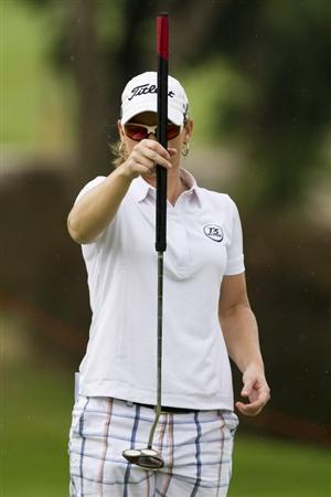 CHON BURI, THAILAND - FEBRUARY 20:  Kristy McPherson of USA lines up a putt on the 8th green during round three of the Honda PTT LPGA Thailand at Siam Country Club on February 20, 2010 in Chon Buri, Thailand.  (Photo by Victor Fraile/Getty Images)