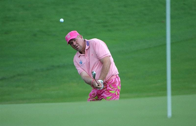 SAN ANTONIO, TX- MAY 13:  John Daly hits a short chip shot to the  2nd hole during the first round of the Valero Texas Open at the TPC San Antonio on May 13, 2010 in San Antonio, Texas. (Photo by Marc Feldman/Getty Images)