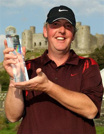 HARLECH, WALES - SEPTEMBER 02:  Simon Edwards of Windermere with the winners trophy after the final round of the RCW2010 Welsh National PGA Championship at the Royal St. David's Golf Club on September 2, 2010 in Harlech, Wales.  (Photo by Ross Kinnaird/Getty Images)