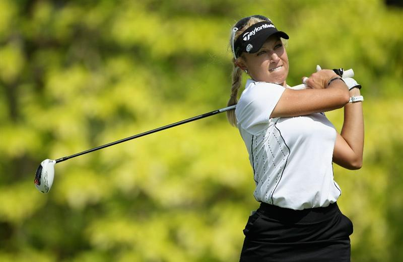 SINGAPORE - FEBRUARY 24:  Natalie Gulbis of the USA hits her tee-shot on the sixth hole during the first round of the HSBC Women's Champions at the Tanah Merah Country Club on February 24, 2011 in Singapore.  (Photo by Andrew Redington/Getty Images)