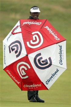 SOUTHPORT, UNITED KINGDOM - JULY 17:  Vijay Singh of Fiji waits under an umbrella during the First Round of the 137th Open Championship on July 17, 2008 at Royal Birkdale Golf Club, Southport, England.  (Photo by Ross Kinnaird/Getty Images)