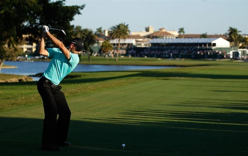 DORAL, FL - MARCH 13:  Charl Schwartzel of South Africa tees off on the ninth tee box during round three of the 2010 WGC-CA Championship at the TPC Blue Monster at Doral on March 13, 2010 in Doral, Florida.  (Photo by Scott Halleran/Getty Images)