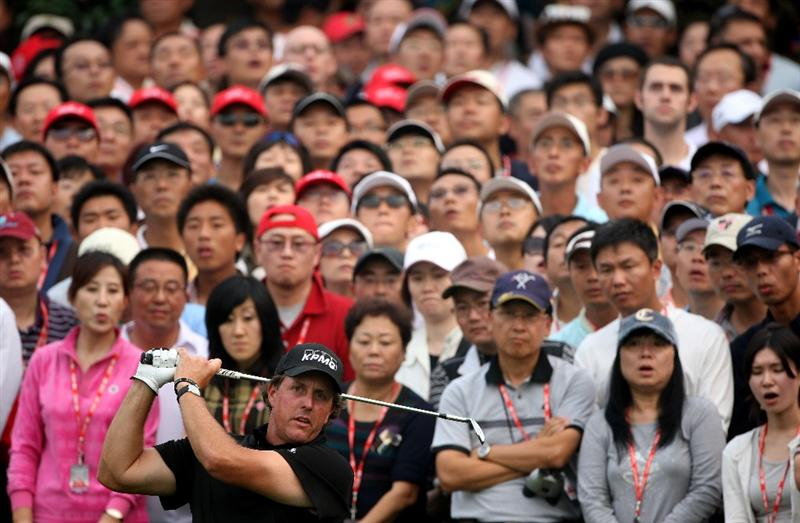 SHANGHAI, CHINA - NOVEMBER 08:  Phil Mickelson of the USA plays a shot on the 16th hole during the final round of the WGC-HSBC Champions at Sheshan International Golf Club on November 8, 2009 in Shanghai, China.  (Photo by Andrew Redington/Getty Images)