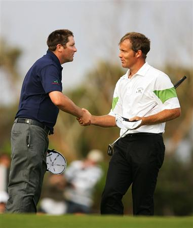 SYDNEY, AUSTRALIA - DECEMBER 04:  Stuart Appleby (R) of Australia shakes hands with Steve Marino of USA after completing their round during the second round of the 2009 Australian Open at New South Wales Golf Club on December 4, 2009 in Sydney, Australia.  (Photo by Matt King/Getty Images)