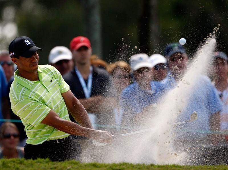 DORAL, FL - MARCH 14:  Tiger Woods holes out from a bunker on the 16th hole during the third round of the World Golf Championships-CA Championship on March 14, 2009 at the Doral Golf Resort and Spa in Doral, Florida.  (Photo by Jamie Squire/Getty Images)
