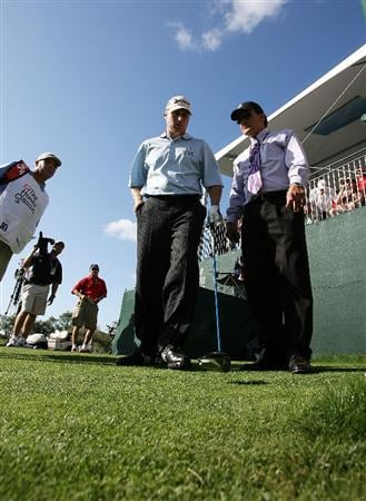 PALM BEACH GARDENS, FL - MARCH 08:  John Rollins gets instructions from a rules official before having to take a drop because his drive went into the stands on the 17th hole during the final round of The Honda Classic at PGA National Resort and Spa on March 8, 2009 in Palm Beach Gardens, Florida.  (Photo by Doug Benc/Getty Images)