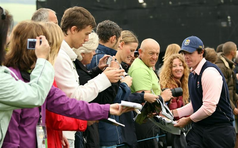 NEWPORT, WALES - SEPTEMBER 30:  Rory McIlroy of Europe signs an autograph during a practice round prior to the 2010 Ryder Cup at the Celtic Manor Resort on September 30, 2010 in Newport, Wales.  (Photo by Ross Kinnaird/Getty Images)
