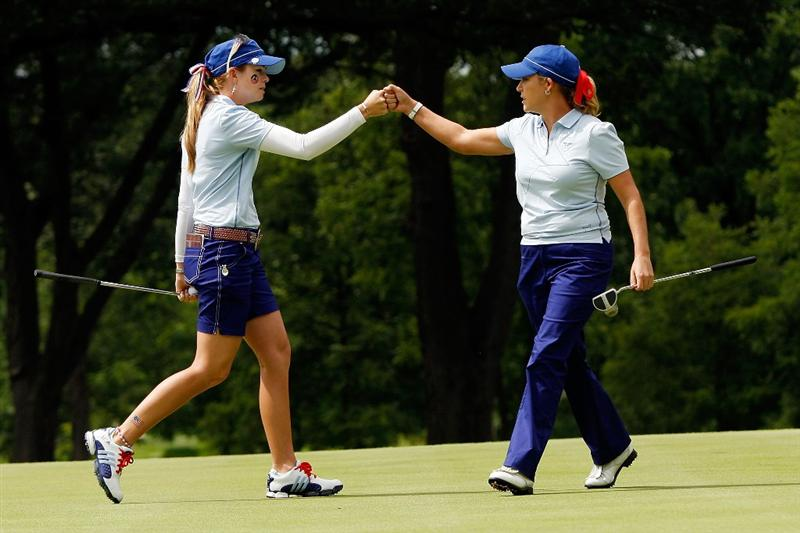 SUGAR GROVE, IL - AUGUST 21:  Paula Creamer left, and Cristie Kerr of the U.S. Team celebrate on the 12th green after winning the hole during the Friday morning Fourball matches at the 2009 Solheim Cup at Rich Harvest Farms on August 21, 2009 in Sugar Grove, Illinois.  (Photo by Chris Graythen/Getty Images)