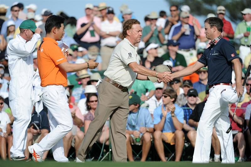 AUGUSTA, GA - APRIL 07:  (L-R) Y.E. Yang of South Korea,Miguel Angel Jimenez of Spain and Zach Johnson congratulate each other after finishing on the 18th hole during the first round of the 2011 Masters Tournament at Augusta National Golf Club on April 7, 2011 in Augusta, Georgia.  (Photo by Harry How/Getty Images)