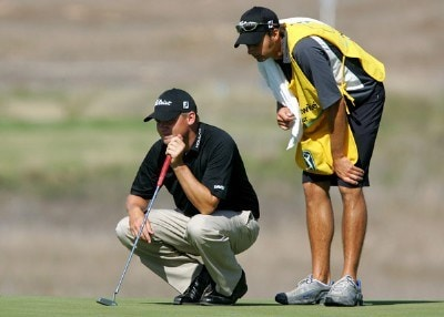 Jon Mills lines up his putt on the fourth hole with the help of his caddie during the second round of the Nationwide Championship at Barona Creek Golf Course November 2, 2007 in Lakeside, California. Nationwide Tour - 2007 Nationwide Tour Championship at Barona Creek - Second RoundPhoto by K.Horner/WireImage.com