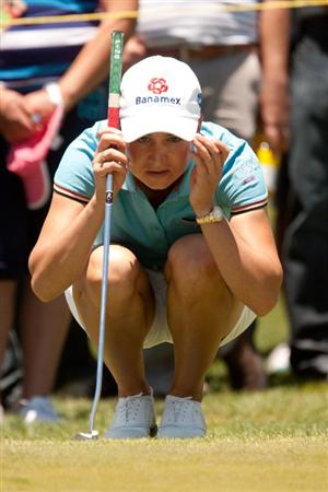 MORELIA, MEXICO - APRIL 30: Lorena Ochoa of Mexico lines up a putt during the second round of the Tres Marias Championship at the Tres Marias Country Club on April 30, 2010 in Morelia, Mexico. (Photo by Darren Carroll/Getty Images)