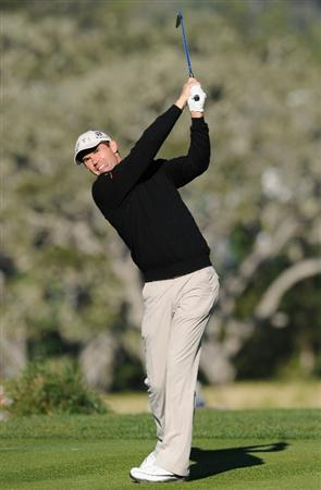 PEBBLE BEACH, CA - FEBRUARY 11:  Padraig Harrington of Ireland plays his tee shot on the sixth hole during the second round of the AT&T Pebble Beach National Pro-Am at the Pebble Beach Golf Links on February 11, 2011  in Pebble Beach, California  (Photo by Stuart Franklin/Getty Images)