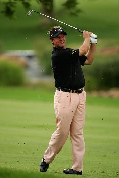 MALELANE, SOUTH AFRICA - DECEMBER 06:  Darren Clarke of Northern Ireland plays his second shot on the 18th hole during the first round of The Alfred Dunhill Championship at The Leopard Creek Country Club on December 6, 2007 in Malelane, South Africa.  (Photo by Warren Little/Getty Images)
