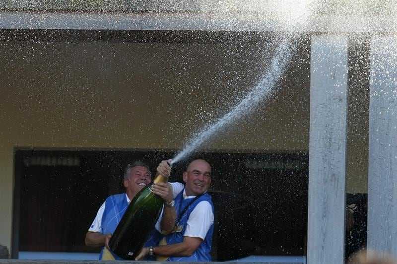 NEWPORT, WALES - OCTOBER 04:  (L-R) Europe Vice Captains Darren Clarke and Thomas Bjorn spray champagne on the balcony of the clubhouse following Europe's victory during the 2010 Ryder Cup at the Celtic Manor Resort on October 4, 2010 in Newport, Wales.  (Photo by Andy Lyons/Getty Images)