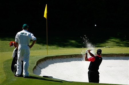 AUGUSTA, GA - APRIL 13:  Tiger Woods  plays a bunker shot on the fourth hole during the final round of the 2008 Masters Tournament at Augusta National Golf Club on April 13, 2008 in Augusta, Georgia.  (Photo by Jamie Squire/Getty Images)