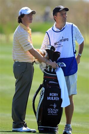 MARANA, AZ - FEBRUARY 27:  Rory McIlroy of Northern Ireland watches a shot on the fourth hole alongside his caddie J.P. Fitzgerald during the third round of the Accenture Match Play Championship at the Ritz-Carlton Golf Club at Dove Mountain on February 27, 2009 in Marana, Arizona.  (Photo by Scott Halleran/Getty Images)