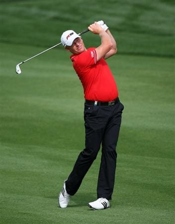 DUBAI, UNITED ARAB EMIRATES - JANUARY 29:  Peter Hedblom of Sweden plays his second shot on the par five 10th hole during the first round of the Dubai Desert Classic on the Majlis Course on January 29, 2009 in Dubai,United Arab Emirates.  (Photo by Ross Kinnaird/Getty Images)