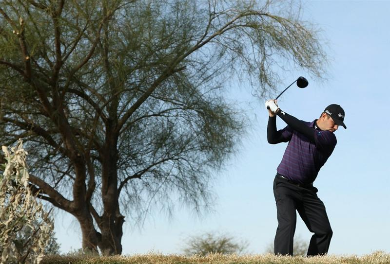 SCOTTSDALE, AZ - FEBRUARY 06:  Chris Couch hits a tee shot on the 13th hole during the third round of the Waste Management Phoenix Open at TPC Scottsdale on February 6, 2011 in Scottsdale, Arizona.  (Photo by Christian Petersen/Getty Images)