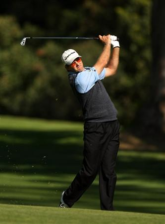 PACIFIC PALISADES, CA - FEBRUARY 18:  Retief Goosen of South Africa hits from the fairway on the 13th hole during a practice round before the Northern Trust Open on February 18, 2009 at Riviera Country Club in Pacific Palisades. California.  (Photo by Stephen Dunn/Getty Images)