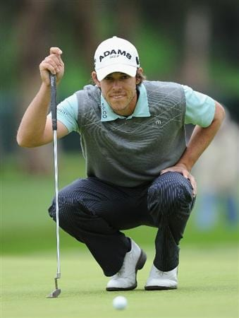 PACIFIC PALISADES, CA - FEBRUARY 19:  Aaron Baddeley of Australia lines up his putt on the 17th hole during the third round of the Northern Trust Open at Riviera Country Club on February 19, 2011 in Pacific Palisades, California.  (Photo by Stuart Franklin/Getty Images)