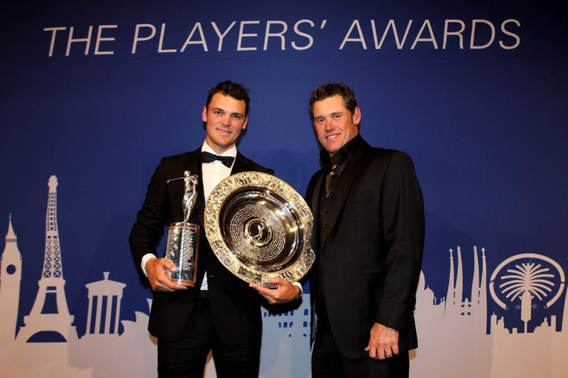 VIRGINIA WATER, ENGLAND - MAY 24:  Martin Kaymer (L) of Germany is presented with the Harry Vardon Trophy and Players' Player of the Year Award by Lee Westwood of England during the European Tour Dinner at The Wentworth Club on May 24, 2011 in Virginia Water, England.  (Photo by Andrew Redington/Getty Images)