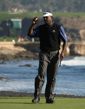 PEBBLE BEACH, CA - FEBRUARY 10:  Vijay Singh of Fiji hits holds up his ball after his birdie on the 18th hole forced a playoff during the final round of the AT&T Pebble Beach National Pro-Am on Pebble Beach Golf Links on February 10, 2008 in Pebble Beach. California.   (Photo by Stephen Dunn/Getty Images)