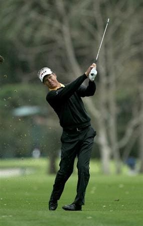 PACIFIC PALISADES, CA - FEBRUARY 18:  John Senden of Australia hits his second shot on the 11th hole during round two of the Northern Trust Open at Riviera Country Club on February 18, 2011 in Pacific Palisades, California.  (Photo by Stephen Dunn/Getty Images)