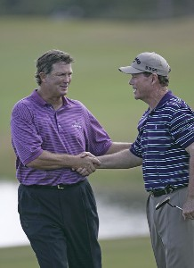 Peter Jacobsen (L) and Tom Wason (R) shake hands after the first round of the ACE Group Classic held at the TwinEagles GC in Naples, Florida on February 17, 2006.Photo by Sam Greenwood/WireImage.com