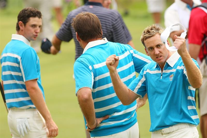 LOUISVILLE, KY - SEPTEMBER 20:  Ian Poulter of the European team celebrates on the 15th green after winning 4&3 with playing partner Justin Rose (L) and captain Nick Faldo during the morning foursome matches on day two of the 2008 Ryder Cup at Valhalla Golf Club on September 20, 2008 in Louisville, Kentucky.  (Photo by Andrew Redington/Getty Images)