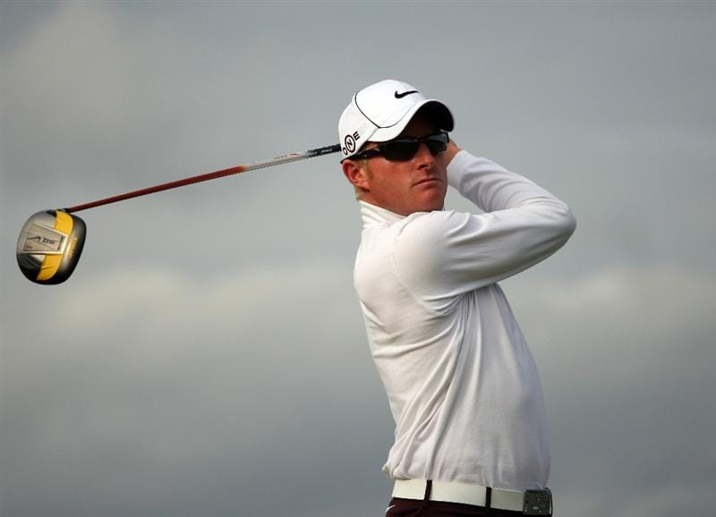 ST ANDREWS, SCOTLAND - OCTOBER 05:  Simon Dyson of England drives off the 14th tee during the final round of The Alfred Dunhill Links Championship at The Old Course on October 5, 2009 in St.Andrews, Scotland.  (Photo by Andrew Redington/Getty Images)