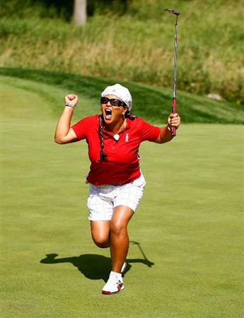 SUGAR GROVE, IL - AUGUST 23:  Christina Kim of the U.S. Team celebrates a birdie putt on the 16th green during the Sunday singles matches at the 2009 Solheim Cup at Rich Harvest Farms on August 23, 2009 in Sugar Grove, Illinois.  (Photo by Scott Halleran/Getty Images)
