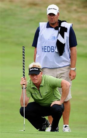 ZANDVOORT, NETHERLANDS - AUGUST 21:  Peter Hedblom of Sweden and caddie line up his putt on the nineth hole during the second round of The KLM Open at Kennemer Golf & Country Club on August 21, 2009 in Zandvoort, Netherlands.  (Photo by Stuart Franklin/Getty Images)