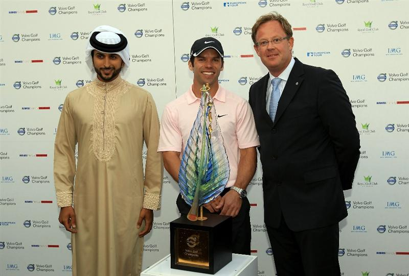 BAHRAIN, BAHRAIN - JANUARY 30:  Paul Casey of England with the trophy and His Highness Shaikh Nasser Bin Hamed Al Khalifa The Chairman of the Supreme Council for Youth and Sport and President of the Bahrain Olympic Committee and Per ericsson The CEO of Volvo Event Management after the final round of the 2011 Volvo Champions held at the Royal Golf Club on January 30, 2011 in Bahrain, Bahrain.  (Photo by David Cannon/Getty Images)
