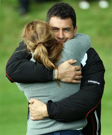 GLENEAGLES, SCOTLAND - SEPTEMBER 28:  Isabella Deilert celebrates with team captain Gary Stangl after halving the eighteenth hole with Cassy Isagawa during the second day of play at the Junior Ryder Cup at Gleneagles on September 28 2010 near Muirton, Scotland. (Photo by Ian MacNicol/Getty Images)