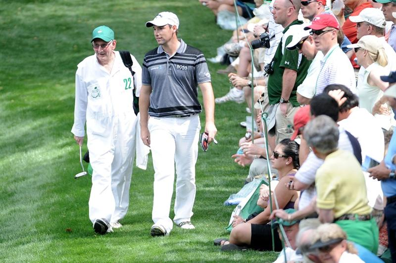 AUGUSTA, GA - APRIL 07:  Oliver Wilson of England walks with his caddie/father during the Par 3 Contest prior to the 2010 Masters Tournament at Augusta National Golf Club on April 7, 2010 in Augusta, Georgia.  (Photo by Harry How/Getty Images)