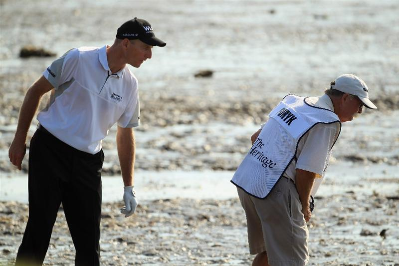 HILTON HEAD ISLAND, SC - APRIL 24:  Jim Furyk and his caddie 'Fluff' look for his ball on the 18th hole during the final round of The Heritage at Harbour Town Golf Links on April 24, 2011 in Hilton Head Island, South Carolina.  (Photo by Streeter Lecka/Getty Images)