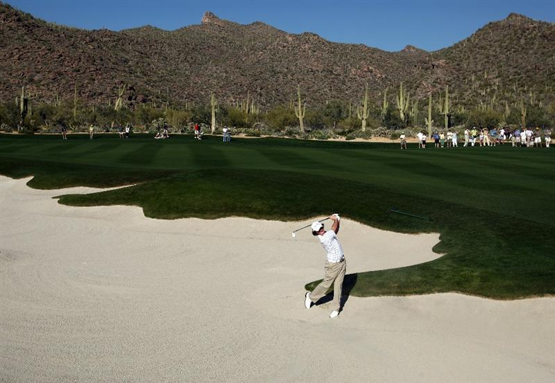 MARANA, AZ - FEBRUARY 26:  Rory McIlroy of Northern Ireland hits his 2nd shot out of the 17th fairway bunker en route to his 1-UP victory over Hunter Mahan of the USA during the second round of the Accenture Match Play Championships at the Ritz-Carlton Golf Club at Dove Mountain on February 26, 2009 in Marana, Arizona. (Photo by Donald Miralle/Getty Images)