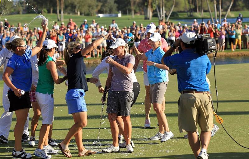 RANCHO MIRAGE, CA - APRIL 03:  Stacy Lewis of the USA is drenched in champagne by other players after she had secured victory on the 18th green during the final round of the 2011 Kraft Nabisco Championship on the Dinah Shore Championship Course at the Mission Hills Country Club on April 3, 2011 in Rancho Mirage, California.  (Photo by David Cannon/Getty Images)