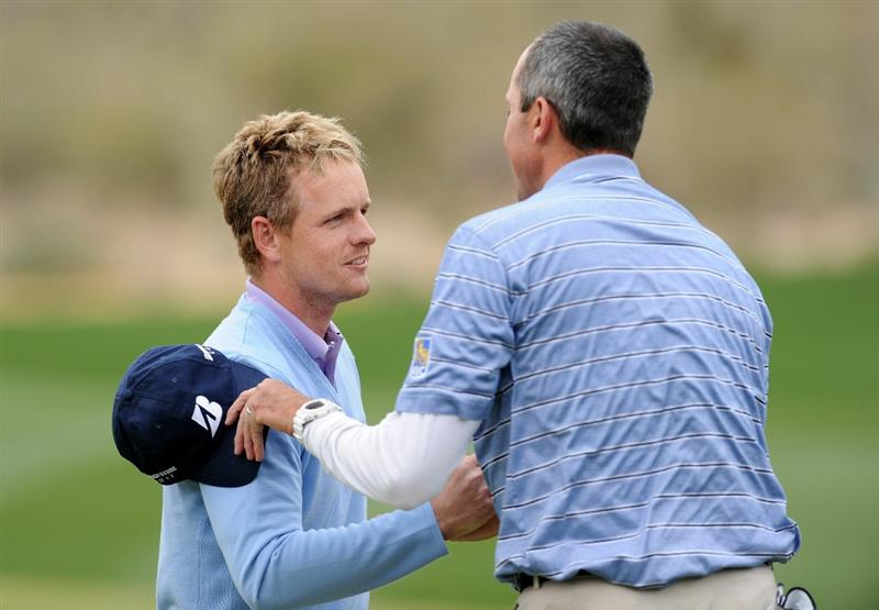 MARANA, AZ - FEBRUARY 26:  Matt Kuchar (R) congratulates Luke Donald of England (L) on his victory on the 13th hole during the semifinal round of the Accenture Match Play Championship at the Ritz-Carlton Golf Club on February 26, 2011 in Marana, Arizona.  (Photo by Stuart Franklin/Getty Images)