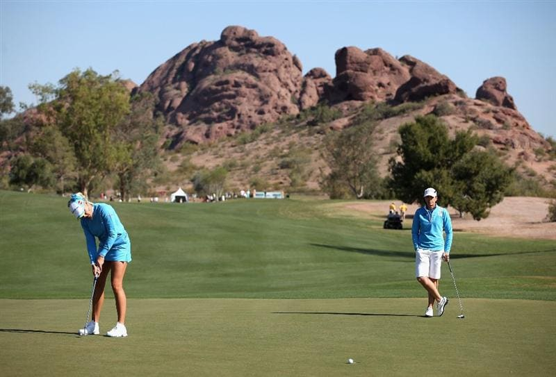 TEMPE, AZ - MARCH 26:  Natalie Gulbis (L) putts on the 12th hole green as Juli Inkster watches during the first round of the J Golf Phoenix LPGA International golf tournament at Papago Golf Course on March 26, 2009 in Tempe, Arizona.  (Photo by Christian Petersen/Getty Images)